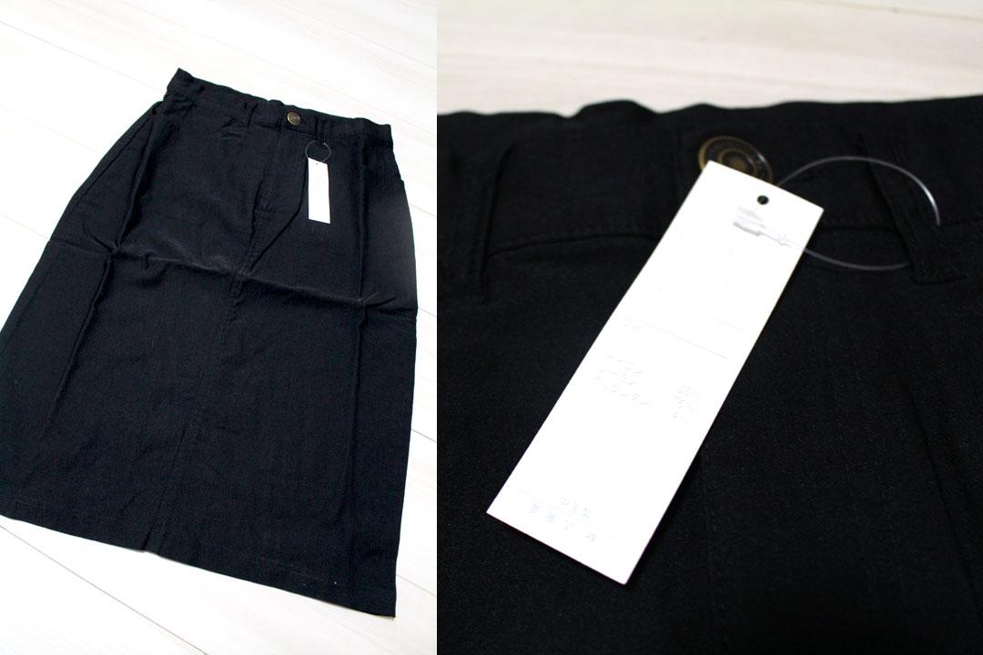 膝丈ストレッチスカートのLサイズ、ブラック。床に平置きでボタンのアップです。
